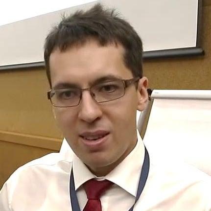 Юрий Плужник, КПМГ
