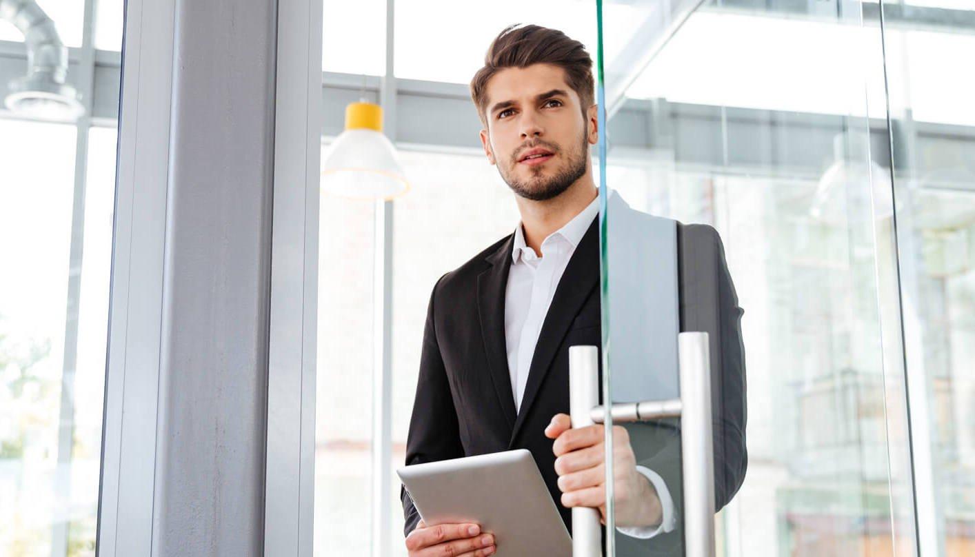 1businesman-with-tablet-entering-the-door-in